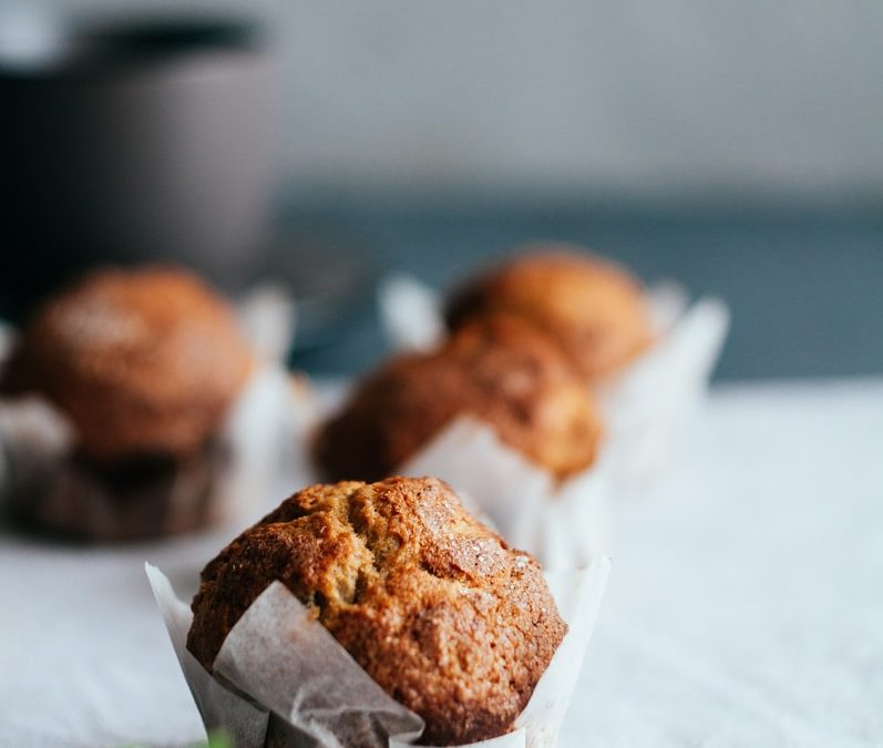 baked muffin on beige surface
